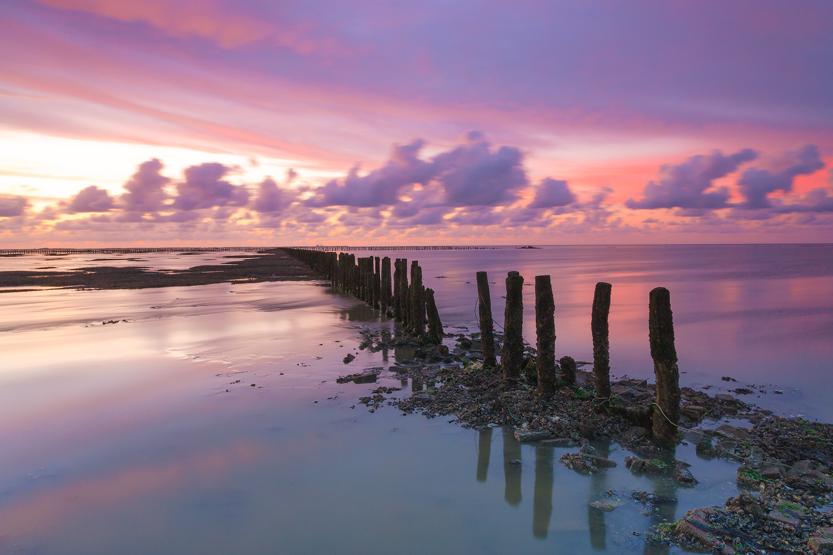 A colorful and dramatic sunset over the Wadden sea near Ternaard