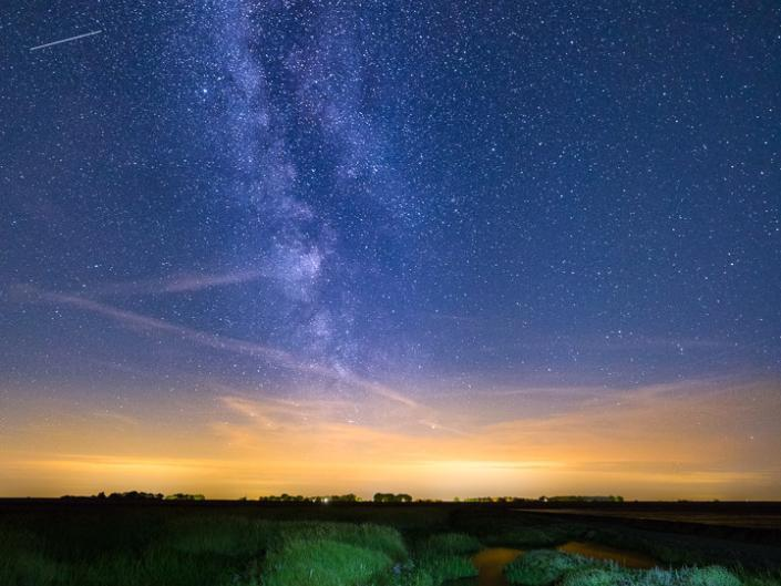 The Milky Way above the Wadden Sea, The Netherlands Had a great time last night trying to capture the Perseids. Canon Eos 6D Mark II with a 14mm f/2.8. Blended in Photoshop from 2 images. One image exposed for the foreground and one for the sky.