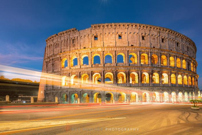 The Roman Colosseum and a blue sky with pink colors in the background - Travel image, Rome, Italy