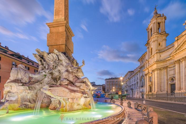 Piazza Navona at dawn with the famous Fontana dei Quattro Fiumi fountain made by Bernini in Rome, Italy