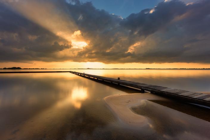 Een prachtige zonsondergang boven het Schildmeer in de provincie Groningen - Bas Meelker Landschapsfotografie