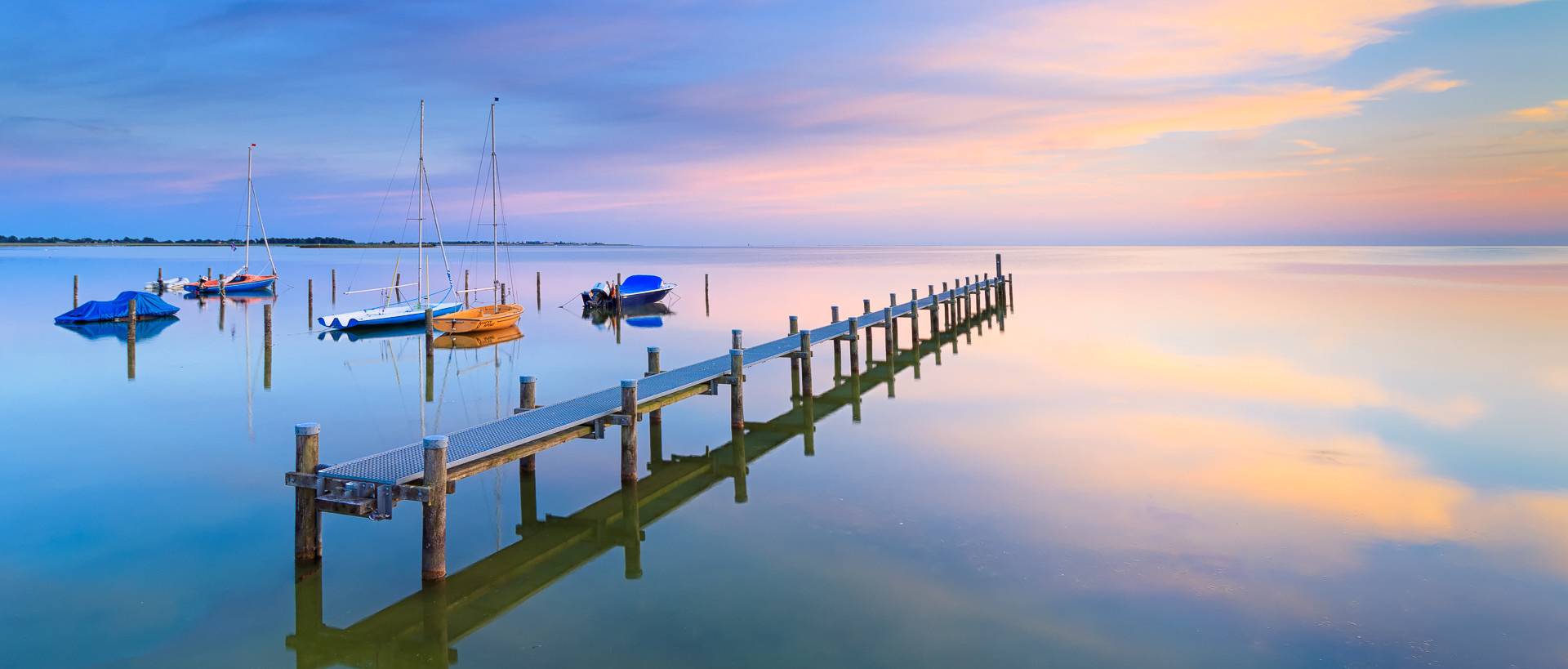 A tranquil and calm summer evening at Lake IJsselmeer near Hindeloopen, The Netherlands