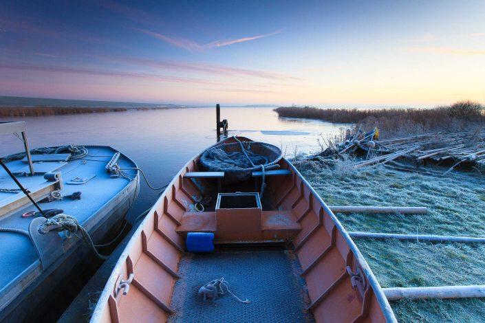 Zonsopkomst boven de ouden haven bij de Hoek van Bant aan het Lauwersmeer