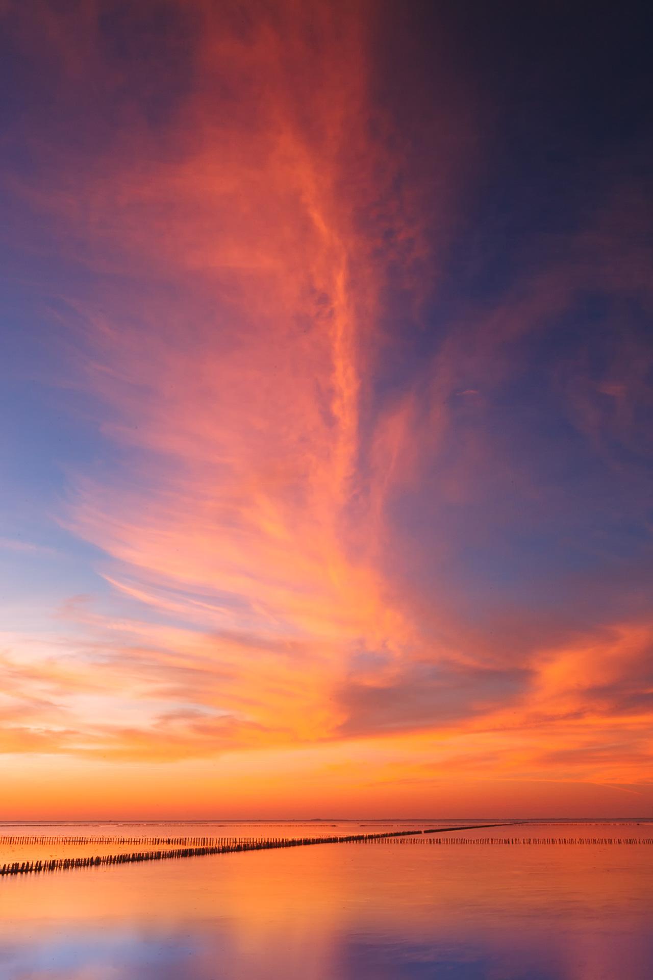 Landschapsfotografie en Muziek - Zonsondergang boven de Waddenzee, 10 september 2004. Een van de vele avonden aan het wad, lerend, experimenterend en genietend.
